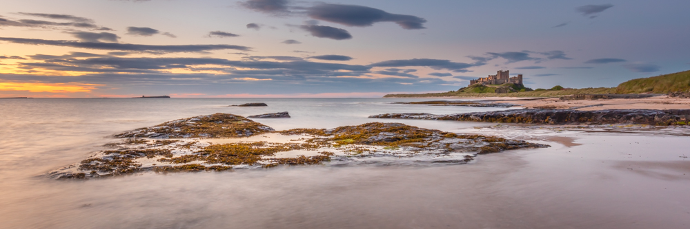 Bamburgh Castle on a summer morning with a long exposure shot
