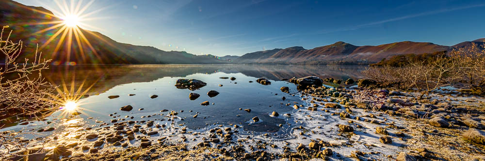 Winter Sunrise starburst with Borrowdale and Calfclose Bay