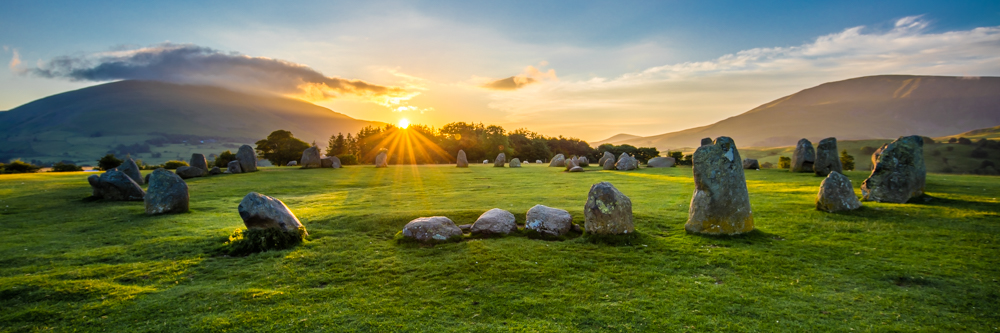 CastleRigg stone circle on a midsummer Sunrise at first light