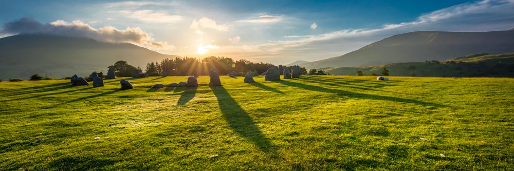 CastleRigg stone circle on a midsummer Sunrise and the long shadows