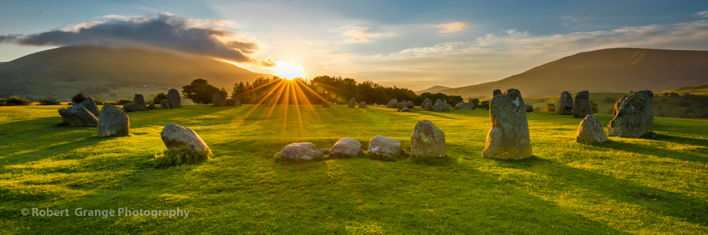 CastleRigg stone circle on a midsummer Sunrise at the moment of full sun