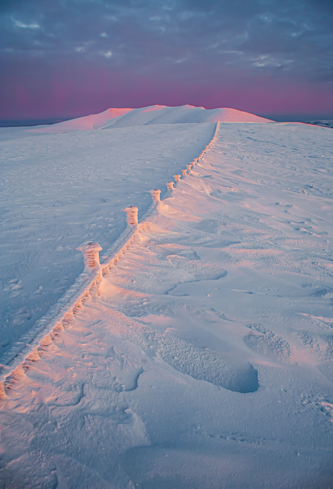 Blencathra at sunset form a snow carpeted Lonscale fell